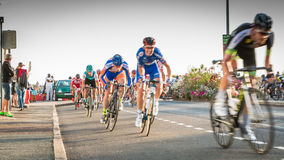 Cyclist in acceleration during a night race. Saint Hilaire de Riez, France - August 10, 2016 : competitors in a night bike race, the 35th Trophy Louis Caiveau Royalty Free Stock Photo