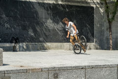 Cyclist acrobat. Young man doing tricks on his  bicycle Stock Photography