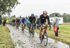 The Cyclist Adam Hansen on a Cobbled Road - Tour de France 2014 Royalty Free Stock Image