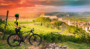 Cyclist admires the Soave castle views. Stock Photography