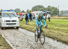 The Cyclist Alessandro Vanotti on a Cobbled Road - Tour de Franc. Ennevelin, France - July 09,2014: The Italian cyclist Alessandro Vanotti (Team Astana ) riding Royalty Free Stock Image
