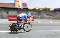 The Cyclist Alex Howes. Perigueux, France - July 26, 2014: Panning image of the American cyclist Alex Howes  (Garmin-SharpTeam) pedaling during the stage 20 ( Royalty Free Stock Photography