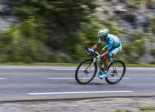 The Cyclist Alexey Lutsenko. Chorges, France- July 17, 2013: The Kazakhstani cyclist Alexey Lutsenko from  Astana Team pedaling during the stage 17 of 100th Royalty Free Stock Photo