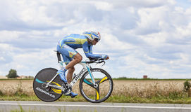 The Cyclist Andrij Grivko. Beaurouvre,France,July 21st 2012:The Ukrainian cyclist Andrij Grivko from Team Astana pedaling during the 19th stage of Le Tour de Royalty Free Stock Photo