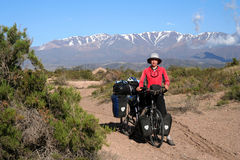 Cyclist in Argentina. Woman cyclist having break while travelling through remote parts of northern Argentina Stock Photo