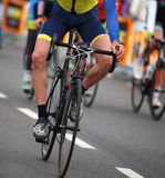 cyclist without a arm with the bike in the city race Stock Photos