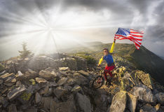 Cyclist in the autumn mountains. American racer autumn marathon route passes the tourist route in the wild mountains and fortified trenches dug the First World stock photo