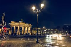 Cyclist on backside of the Brandenburg Gate at night stock photos