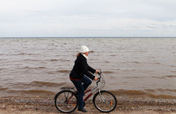 Cyclist at Baltic sea. Stock Photo