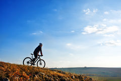 Cyclist on the Beautiful Meadow Trail on sunny day Royalty Free Stock Photos