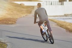 Cyclist from behind royalty free stock images