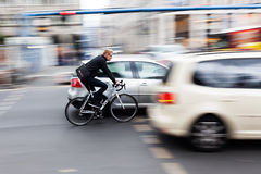 Cyclist in Berlin, Germany, in motion blur Royalty Free Stock Photos