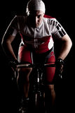 Cyclist on a bicycle. Fully equipped cyclist riding a bicycle stock photo
