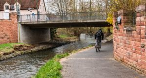 Cyclist on the bicycle path on the banks of the river. royalty free stock photo