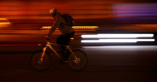Cyclist in big city background Royalty Free Stock Images