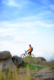 Cyclist with Bike in the Beautiful Mountains Stock Photography