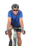 Cyclist on bike closeup. Closeup of a smiling man on a road bike isolated on white. Head on shot in vertical format showing only top half of bike Royalty Free Stock Photo