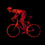 Cyclist in a bike race on black background Stock Photography