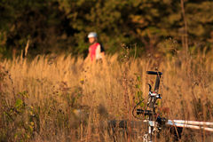 Cyclist with bike relax in the sunny autumn park Stock Photography