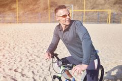 Cyclist with bike on the sand stock image