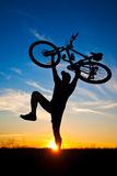 Cyclist with a bike silhouette on blue sky Stock Photo