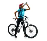 Cyclist in blue t-shirt with bicycle drinking a water Stock Images