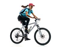 Cyclist in blue t-shirt riding the bike. In silhouette on white background. Dynamic movement. Sport and healthy lifestyle royalty free stock images