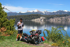 Cyclist break by the lake Stock Image