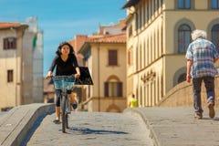 Cyclist on Bridge Santa Trinita, Florence, Italy Royalty Free Stock Photos
