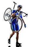 Cyclist carrying bicycle silhouette Royalty Free Stock Photos