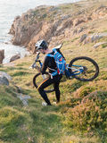 Cyclist carrying your bike on the Galician coast. Stock Images