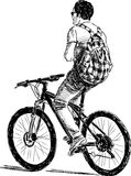 Cyclist with checkered backpack Stock Images