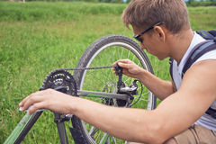 Cyclist checks chain Stock Image