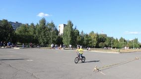 Cyclist child jumps into Big Air Bag during Aeromat jumps championship of Perm region stock footage