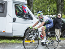 The Cyclist Christian Meier. Le Markstein, France- July 13, 2014:The Canadian cyclist Christian Meier of Orica-GreenEDGE Team , climbing the road to mountain Stock Images