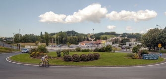 Cyclist circulating in a roundabout Royalty Free Stock Photo