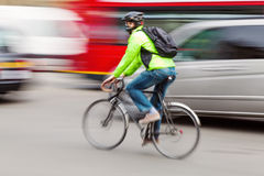 Cyclist in the city in motion blur Stock Images