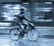 Cyclist on the city roadway Stock Image