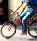 Cyclist on the city roadway Royalty Free Stock Photos