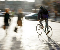 Cyclist on the city roadway. In motion blur Stock Photography