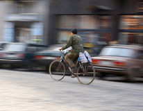 Cyclist on the city roadway Royalty Free Stock Images