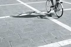 Cyclist in city at sunny day Royalty Free Stock Photos