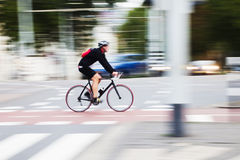 Cyclist in city traffic Royalty Free Stock Photography