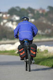Cyclist Commuting. Cyclist on a seaside path stock photo