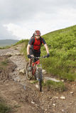 Cyclist On Countryside Muddy Track Royalty Free Stock Photo