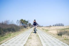 Cyclist on countryside track. Teenage male cyclist on track in countryside Royalty Free Stock Photo