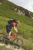 Cyclist On Countryside Track. Side view of a male cyclist on countryside track Royalty Free Stock Photos