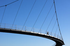 Cyclist crossing a bridge Royalty Free Stock Photography