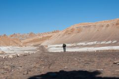 Cyclist in the Atacama Desert. Cyclist crossing the roads of the Atacama desert. The driest desert on the planet Royalty Free Stock Photo