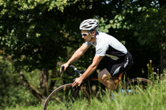 Cyclist in a curve Royalty Free Stock Photos
